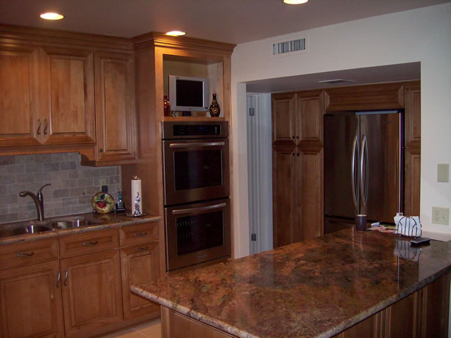 Additional new kitchen photo,notice pantry built-in cabinets and refrigerator at existing pantry. We also renovated the master bath room and added an bathroom to this home.