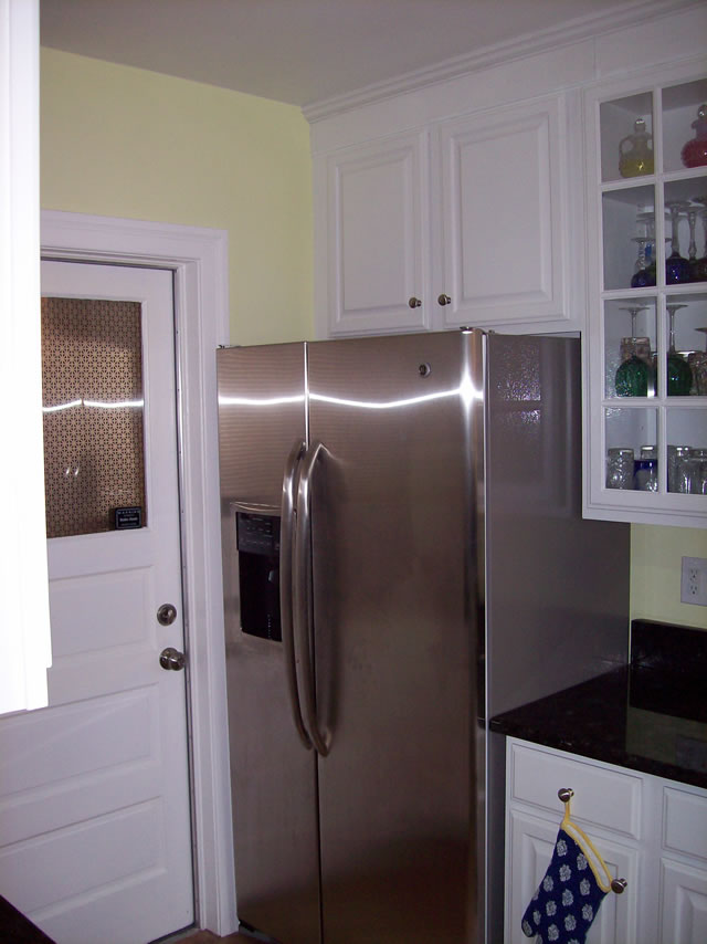 After photos of kitchen renovations with new appliances.